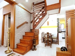 Stone Wall and Wooden Stairs a Perfect Combination....:  Living room by Nishtha interior