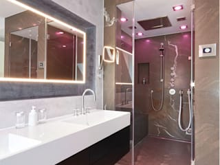 Baños de estilo moderno por HUBER NATURSTEIN bei München