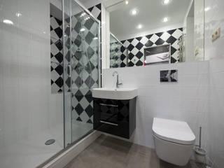 Квартира на Арбате от ARTof3L: Ванные комнаты в . Автор – Дизайн-студия «ARTof3L»