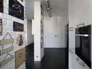 Białe na Czarnym: styl , w kategorii Salon zaprojektowany przez GOSZCZDESIGN