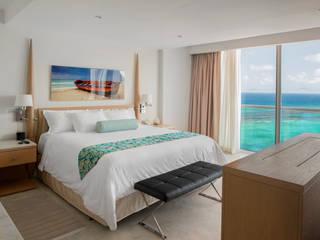 Moon Palace Jamaica Grande: Hoteles de estilo  por Marbol industria Mueblera