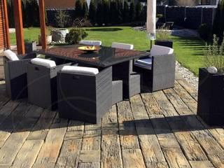 Terrazas de estilo  por Rimini Baustoffe GmbH