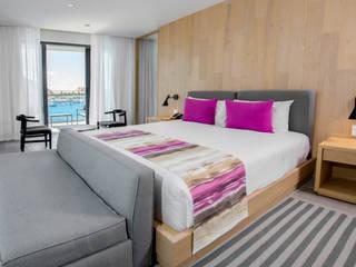 Breathless Los Cabos San Lucas.: Hoteles de estilo  por Marbol industria Mueblera