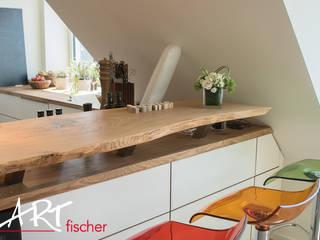 Küchentresen: moderne Küche von ARTfischer Die Möbelmanufaktur.