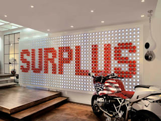 Surplus - Clothing & more concept store: Negozi & Locali commerciali in stile  di Studio Angelo Luigi Tartaglia