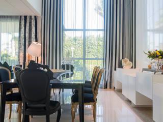 Dining room by Rodrigo Maia Arquitetura + Design