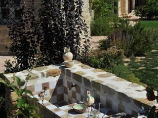 CUCINARE ALL'APERTO Giardini Giordani GiardinoBracieri & Barbecue Piastrelle