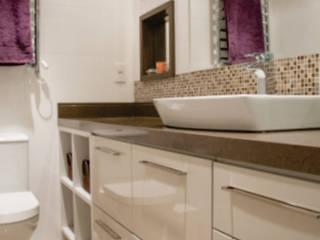 banho casal:   por Cintia Sauner Arquitetura e interiores