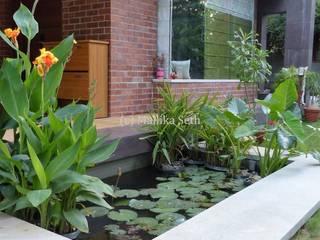 Casas de estilo industrial de Mallika Seth Industrial