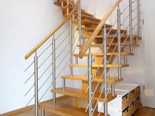 Ein individuelles Möbelstück ganz nach dem Geschmack der Hausherren:   von STREGER Massivholztreppen GmbH