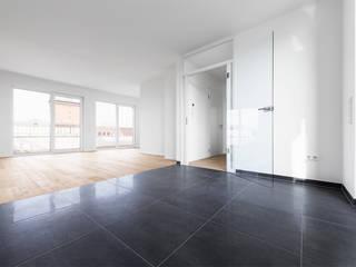 Die Baulücke in der Stadt Moderne Wohnzimmer von Hellmers P2 | Architektur & Projekte Modern