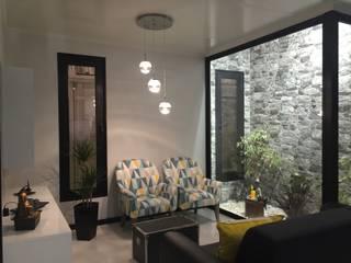 Salas / recibidores de estilo  por KITUR,