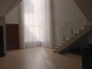 Interior Residência: Salas de estar  por Martin.Perham  Arquitetura