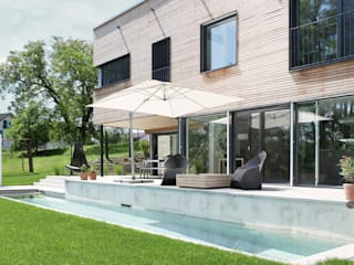 Villa aus Holz am Murtensee Moderne Pools von Unica Architektur AG Modern