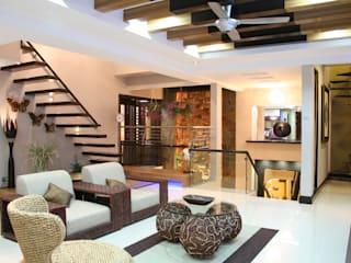 Tropical style living room by Design Spirits Tropical