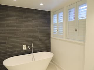 Ideal for bathrooms:  Bathroom by Premier Blinds, Shutters & Awnings