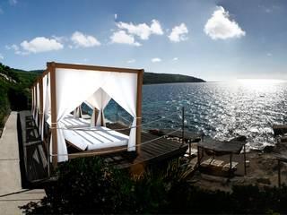 camas balinesas : Hoteles de estilo  de Ale debali study