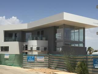 Vivienda moderna en construcción, casi acabada acabada. de DYOV STUDIO Arquitectura, Concepto Passivhaus Mediterraneo 653 77 38 06 Mediterráneo Caliza