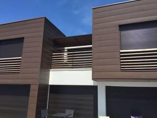 zinc en suspension Maisons modernes par KER I.M.M.O. Moderne