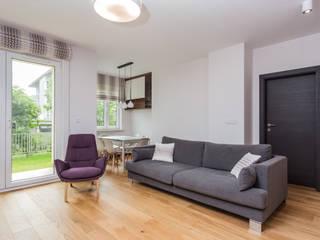 Moderne Wohnzimmer von Kameleon - Kreatywne Studio Projektowania Wnętrz Modern