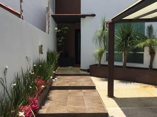 Pasillos y recibidores de estilo  por AMG Arquitectura Integral