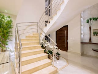 Modern corridor, hallway & stairs by Designer de Interiores e Paisagista Iara Kílaris Modern Marble