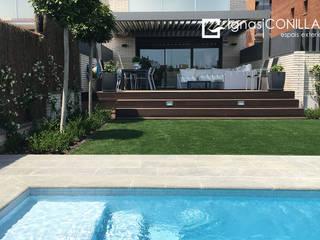 Family garden: Jardines de estilo moderno de CONILLAS - exteriors