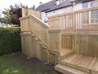 High level garden decking project. Modern garden by Bradshaw contracts ltd Modern