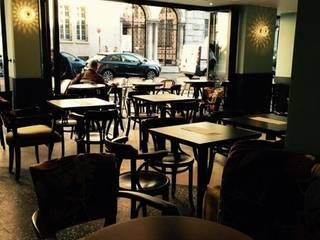 CAFÈ MARIE Bares e clubes modernos por M.M. Lampadari Moderno