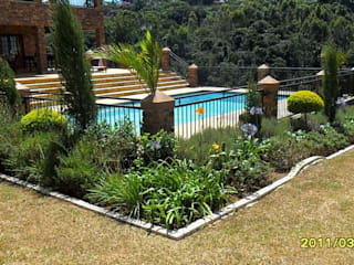 LARGE FORMAL GARDEN IN GILLITTS:  Garden by Paul's Plantscapes, Modern