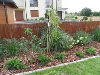 Przykładowe realizacje: styl , w kategorii Ogród zaprojektowany przez Empart Ogrody