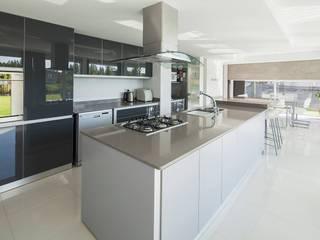Casa M: Cocinas de estilo  por DMS Arquitectura