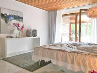 Dormitorios de estilo  de Münchner home staging Agentur GESCHKA, Rural