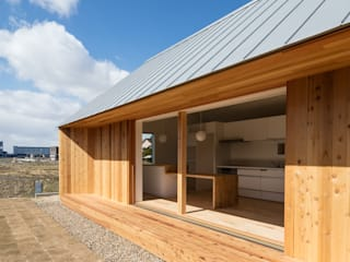 House in Inuyama: hm+architects 一級建築士事務所が手掛けた窓です。,