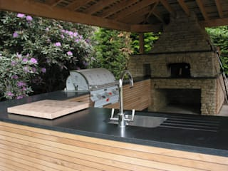 Outdoor kitchen in oak by wood-fired oven