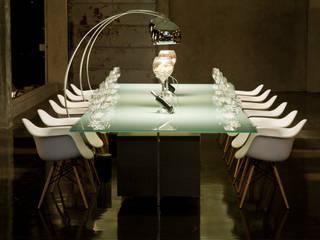 Cadeiras para sentar e admirar por Rivatti Móveis Eclético