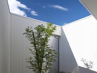 Modern Garden by アトリエハコ建築設計事務所/atelier HAKO architects Modern