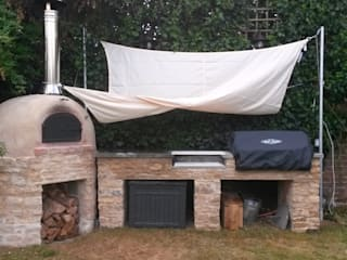 outdoor kitchen with wood-fired oven Jardins rústicos por wood-fired oven Rústico