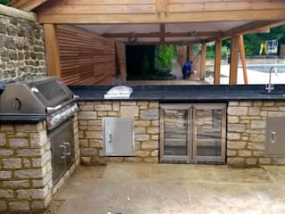 outdoor kitchen by wood-fired oven Сучасний