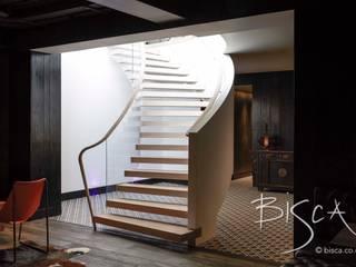Basement Helical Staircase Design 4389 Bisca Staircases Salas multimedia de estilo ecléctico