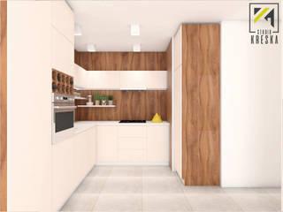 Kuchnia we Wrocławiu - drewno na pierwszym planie: styl , w kategorii  zaprojektowany przez Kreska. Studio projektowania wnętrz.