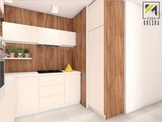 Kuchnia we Wrocławiu - drewno na pierwszym planie od Kreska. Studio projektowania wnętrz.