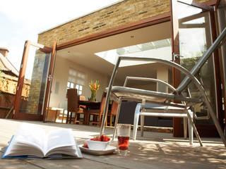 Aumenta a família, aumenta a casa Architect Your Home Jardins modernos
