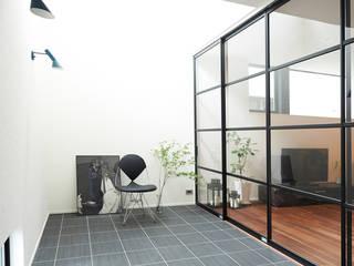 静と動: 株式会社スタジオ・チッタ Studio Cittaが手掛けた壁です。,