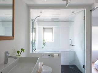 K邸-そしてタイルは「SUBWAY CERAMICS」: 株式会社ブルースタジオが手掛けた浴室です。