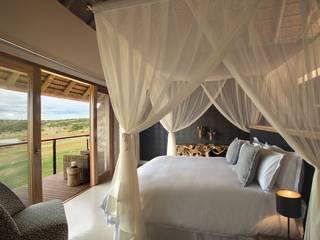 Camera da letto in stile in stile Moderno di All-In Living