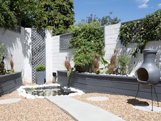 Garden - Greenwich South London por Millennium Interior Designers