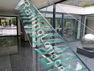 Glass stairs by RailingLondon: modern Corridor, hallway & stairs by Railing London Ltd