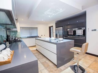 Open plan white gloss kitchen with island Schmidt Kitchens Barnet Kitchen MDF Grey