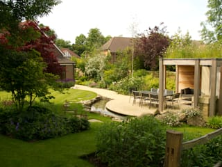 Contemporary Surrey Garden with Outdoor Kitchen. Country style garden by Elks-Smith Landscape and Garden Design Country